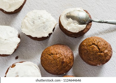 Pumpkin cupcakes on a white background.