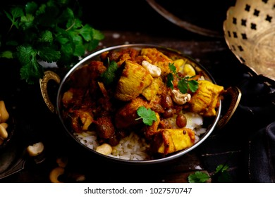 pumpkin curry chicken over cashew rice. .selective focus