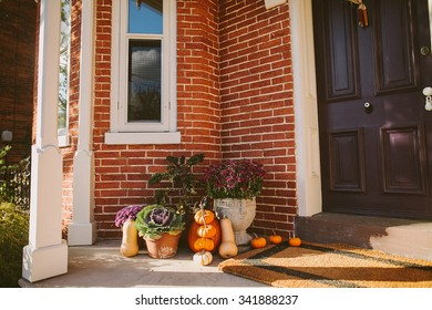 Pumpkin decoration near door outside a house