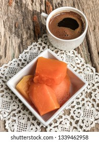 pumpkin dessert and coffee on wooden table