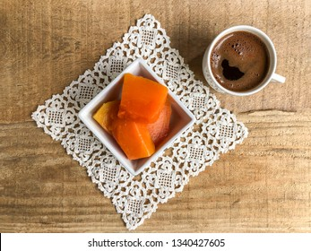 pumpkin dessert and coffee on a wooden table