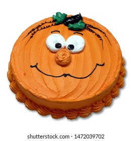 Pumpkin Face Round Cake with Orange Icing and No Cake Board Isolated on a White Background
