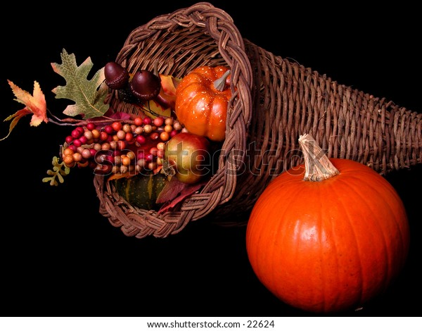 Pumpkin and fall decorations in basket.