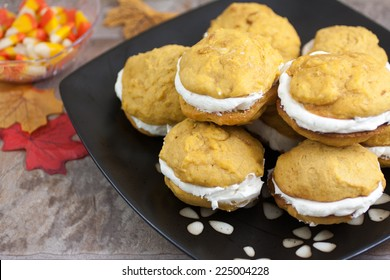 Pumpkin flavored whoopie pie cakes with whipped vanilla cream filling.