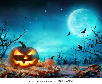 Pumpkin Glowing At Moonlight In The Spooky Forest - Halloween Scene