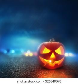 A Pumpkin glowing on Halloween evening.