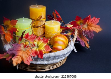 Pumpkin for Halloween with candles in the basket