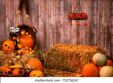Pumpkin heads and autumn props on wooden background