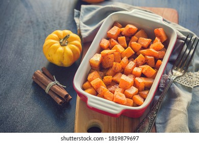 Pumpkin with honey and cinnamon baked in oven