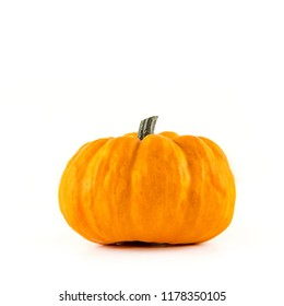 A pumpkin (Jack be little) lies in front of a white background