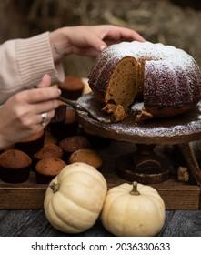 Pumpkin kes and the girl's hands. Autumn still life.