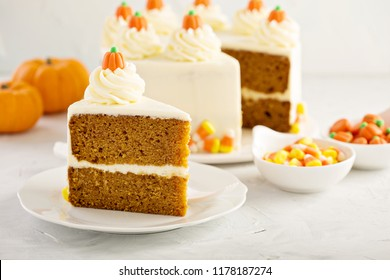 Pumpkin layered cake with cream cheese frosting decorated with candy