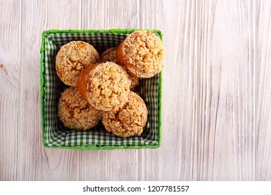 Pumpkin oat muffins with crumble topping in a basket