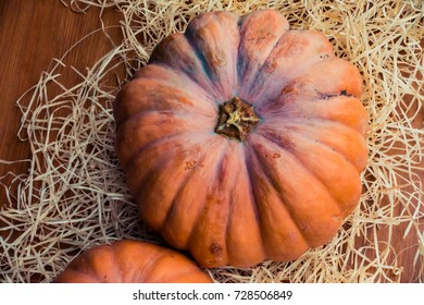 A Pumpkin on a Straw background