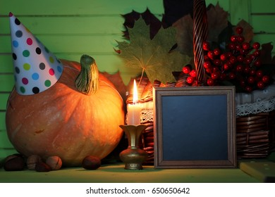 pumpkin on the table holiday candle hat