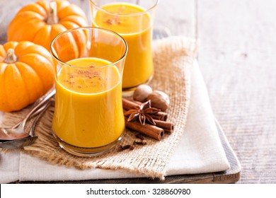 Pumpkin and orange spiced fall drink with cinnamon
