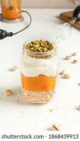 Pumpkin Parfait with Pistachio Crumbs in Glass Mason Jar Mugs