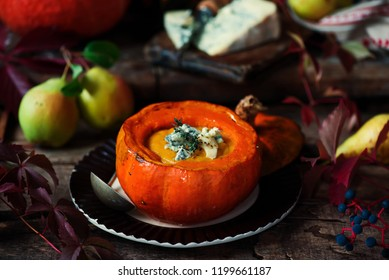 Pumpkin and pear soup with blue cheese..style rustic.selective focus