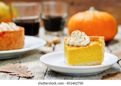 pumpkin pie decorated with whipped cream. toning. selective focus