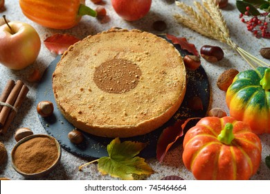 Pumpkin pie on a brown background