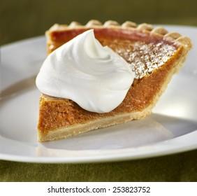 Pumpkin Pie on green background