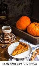 Pumpkin pie on rustic background. Selective focus.