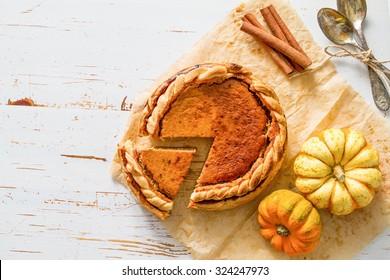Pumpkin pie, white wood background, top view