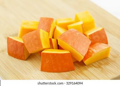 Pumpkin pieces on a wooden board