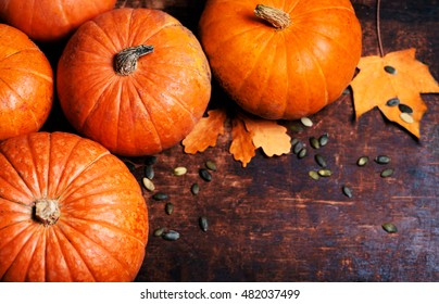 Pumpkin with pieces over wooden table with copy space