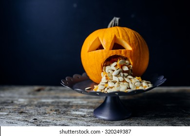 A Pumpkin puking with pumpkin seeds