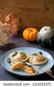 Pumpkin and ricotta ravioli with crispy sage, burnt butter sauce and parmesan