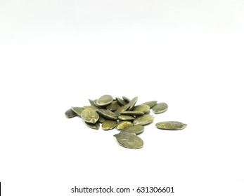 Pumpkin seed or pepitas on isolated white background.