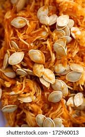 Pumpkin seeds and flesh after carving jack o' lantern