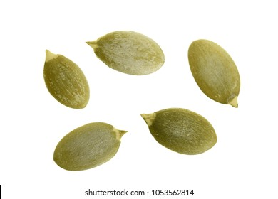 Pumpkin seeds or pepitas, isolated on white background. Top view. Flat lay.