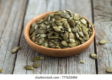 Pumpkin seeds in wooden  bowl