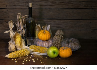 pumpkin with sere fruit and corn whiskey ion old wooden plate / Image still life style