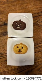 pumpkin shaped cookies and human face for Halloween party