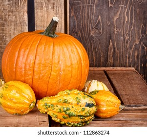 Pumpkin sitting on an old antique wooden crate