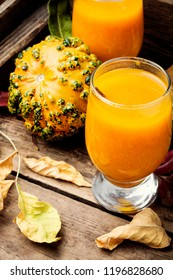 Pumpkin smoothie in glass on vintage table.Autumn drink.