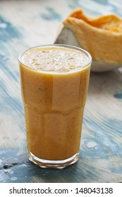 Pumpkin Smoothie. Healthy blended juice on rustic wooden table. Shot on daylight, shallow dept of field.