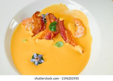 Pumpkin soap with grilled bacon and shrimps