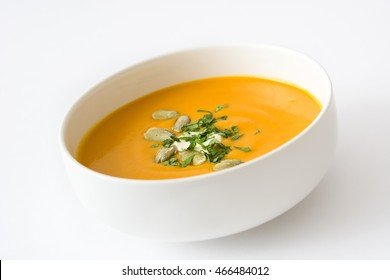Pumpkin soup in bowl isolated on white background