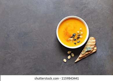 Pumpkin soup with chick pea and pumpkin seeds.