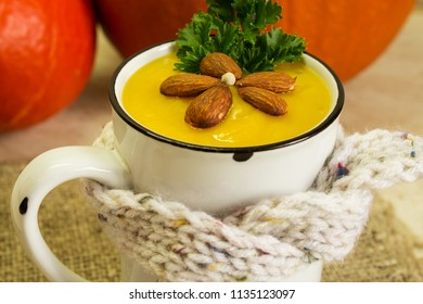 Pumpkin soup. Cream of pumpkin soup with parsley and almonds. A traditional autumn dish.