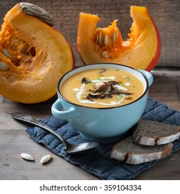 pumpkin soup with forest mushrooms, soy cream and pumpkin seed oil