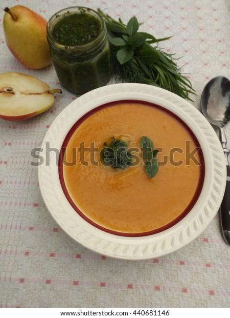 pumpkin soup with green herb butter