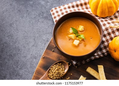 pumpkin soup for Halloween and Thanksgiving party. Harvest and fall autumn season.