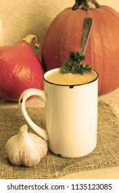 Pumpkin soup. Hot pumpkin soup with parsley and garlic. Close-up. Image in sepia colors.