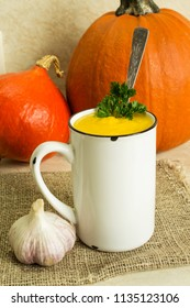 Pumpkin soup. Hot pumpkin soup with parsley and garlic. Close-up. Retro style.