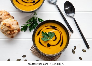 pumpkin soup on a White table